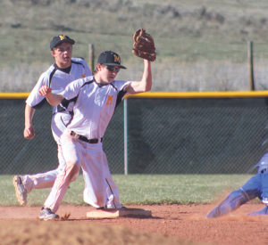 With Meeker shortstop Hunter Garcia backing him up, second-baseman Trapper Merrifield caught the throw from catcher Ty Gibson and prepares to put the tag on a Roaring Fork baserunner. The Cowboys beat the Rams 14-4 in the first home game of the season played in Paintbrush Park on April 7. The Cowboys' next home game is April 21, against the Grand Valley Cardinals.