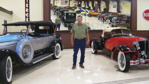 Bud Striegel of Rangely, owner of the Rangely Automotive Museum, stands with some of the cars he initially moved into the museum in 2015. With the museum having started in 2014, Striegel has finally announced that he will publicly open the doors on Saturday.