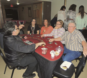 """After the Forks & Flavors dinner held as part of the Pioneers Healthcare Foundation fundraiser event was casino night, when those in attendance could either stay in the main room at the Fairfield Center and dance or go out to the lobby and partake in some fun casino games. One such game was blackjack or """"21"""" as seen above."""