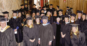 Members of the CNCC staff and faculty await in their regalia for the procession to begin the ceremony.