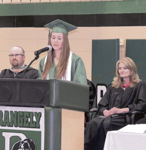 Rangely High School Athletic Director Crandal Mergelman, left, and Counselor Dixie Fielder, right, look on as 2016 Salutatorian Echo Campbell addresses her classmates during commencement exercises on Sunday afternoon in the Rangely High School gymnasium. Valedictorian was Courtney Bell and the student-chosen keynote speaker was Paul Fortunato, who is also the Panther baseball and football coach.
