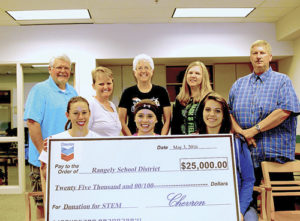 Rangely School District RE-4 board members Kurt Douglas, Leslie Nielsen, Joyce Key, Annette Webber, and Sam Tolley are joined by Rangely High School students Lindzey Thacker, Katelyn Brown and Sarah Conner in saying thank you to Chevron for its continued support of the school district.