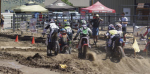 This group of young riders is clustered after leaving the starting line in Saturday's Meeker Moto Mayhem held at the Rio Blanco County Fairgrounds, sponsored by the Western Slope circuit that is headquartered in Montrose. A good crowd was on hand as lots of riders, most from Rio Blanco County, took part in the full day events.