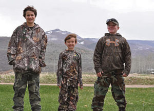 Three Colorado youth participants pose together during their youth turkey hunt in Northwest Colorado, organized by Colorado Parks and Wildlife. From let to right are: 12-year-old Jordan Breck of Grand Junction, 8-year-old Peter McDonald of Fort Collins and 10-year-old Judd Harvey of Meeker.