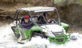 All kinds of Rio Blanco County terrain was encountered by the 160 drivers in the 2016 Wagon Wheel OHV Rendezvous held July 14-16. There was rock terrain, the  flats, the good trails and  the bumpy trails. However, in this case, Meeker riders Jeremy Ahrens and Kaylee Ridings found the wet terrain as they took their OHV ride through Miller Creek, located up County Road 8 east of Meeker. There were all kinds, sizes and colors of OHVs taking part in the rendezvous and riders were from mostly Colorado and surrounding states. A number of events, including a concert, dinners and a poker run were held to give the OHV riders something else to do between runs.