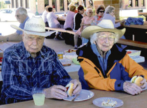 Joe Sullivan celebrated his 97th birthday on Sunday with Ethel Starbuck and several others at the Rio Blanco County Historical Society's quarterly meeting, with lunch being served under the new pavilion on Fifth Street. After lunch, the group gathered to honor the heritage of Meeker's volunteer fire department. Several retired and current firemen were also in attendance.