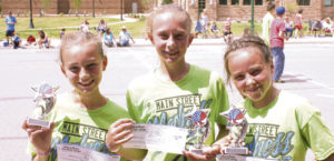 The four members of the Fireworks, a sixth- through eighth-grade girls team competing in the Main Street Madness three-on-three basketball tournament sponsored by the ERBM Recreation and Park District on July 4, won the age competition for the tournament. From left to right are: Jayden Overton, Emma Luce and Brealyn Garcia, all from Meeker. One team that disappeared before their photo was taken was the winning ninth- through 12th-grade team, the Shooting Stars, made up of Julia Dinwiddie and Makenna Burke from Meeker and two girls from Idaho.