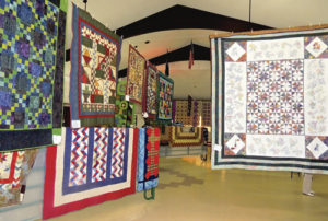 """Quilts in the Country,"" the PEO Annual Quilt Show, will be held Sept. 9 and 10 at the Freeman E. Fairfield Center at 200 Main St. in Meeker, featuring new quilts each year from across Northwest Colorado. The annual show, to benefit educational scholarships and opportunities for women, will be held from 1 to 6 p.m. on Friday and from 9 a.m. to 5:30 p.m. on Saturday during the Meeker Classic Sheepdog Championship Trials. Admission is $3 per person and will also include the annual bake sale and handmade gifts that are designed by the PEO women as a treat for all. Both handmade and machine-made quilts will be featured. At left are some of the quilts from last year's show."