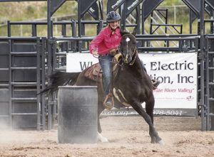adison Kindler of Meeker rounds the barrel as part of her horsemanship competition at the Rio Blanco County Fair on Friday. For her several events within the intermediate class, Kindler took the champion ribbon for performance and champion ribbon for high point.