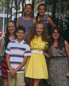 Meeker's youth actors in New York City included, front row, left to right: Ashdon Siebert, Mason Holliday, Annelise Amack and Sena Zellers, and, in the back row, left to right: Savana May and Ruby Holliday. Not pictured are the adults: Gary Zellers, Laurie Zellers and Shana Holliday.
