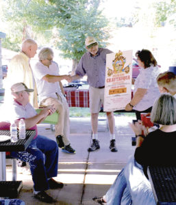 From left: On Aug. 13, Bob Sheets, the first director of the Colorado Council for the Arts, and sound artist Bruce Odland presented Rangely Town Manager Peter Brixius and Town Council member Lisa Hatch with a signed Chautauqua Tour poster to commemorate Odland's first TANK experience in 1976 and The TANK's evolution intothe first Center for Sonic Arts.
