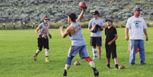 Several middle school and high school football players have been gathering this summer at Barone Middle School's practice field to throw the ball around and give younger kids an opportunity to play alongside older kids like incoming senior Sheridan Harvey, pictured throwing a pass.