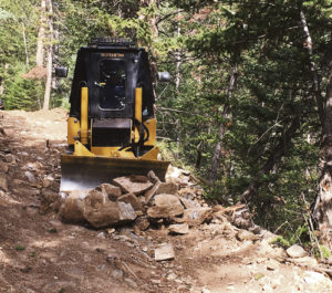 The Forest Service Middle Mountain OHV Trail #2200, in the Miller Creek area east of Meeker, was regraded and stabilized. The Yampa Valley Trail Runners OHV Club from Craig provided the dozer and crew with funding through the Colorado OHV Registration Grant Program. Several members of the Wagon Wheel OHV Club in Meeker assisted with the project. Eight days were spent completing the trail work in July and August. The Wagon Wheel OHV Club is currently developing several grant proposals to fund future trail work and acquire additional equipment.