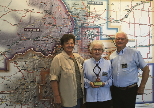Jennifer Hill photo Colorado Visitor Center manager Cheryl McDonald commends Dorothy and Tom Collins on their Jack Snow Award for Outstanding Volunteer, a testimony to their 23 years and almost 6,000 volunteer hours at the visitor center.