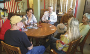 courtesy photo Colorado State Senate District 8 candidate Emily Tracy, right foreground, talks with and listens to some of the Meeker folks who met up with her at Wendll's last Friday. She and her husband, who live in Breckenridge, were on a swing through the northwest sector of the seven county district.