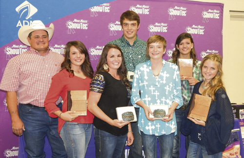 courtesy photo Six members of the Rio Blanco County 4-H livestock judging team were recognized as all-state judges at this year's Colorado State Fair. Left to right: coach Clint Shults, Marryn Shults, Madi Shults, Ty Dunham, Macy Collins, Kacey Lapp and Tatum Kennedy.