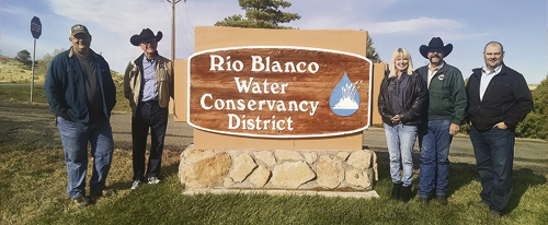 State Senator Randy Baumgardner and State Representative Bob Rankin visited the Rio Blanco Water Conservancy District recently to review the Wolf Creek Reservoir project. The Wolf Creek Reservoir is moving forward and its benefits should create new opportunities for recreation and tourism, which would help local business owners in the town of Rangely. A few details should be highlighted as a follow-up to last week's story.   The price tag for the proposed 90,000 acre-foot reservoir is $133 million. Dredging Kenney Reservoir would cost $700 million. It is noteworthy that Kenney Reservoir currently has a 2-megawatt hydroelectric generator/turbine. The importance of the project is highlighted by our need to preserve natural resources. Pictured are Alden Vandenbrink, Rep. Bob Rankin, Rangely Area Chamber of Commerce Director Konnie Billgren, Sen. Randy Baumgarder and Brad McCloud with EIS Solutions from the water conservancy district.  courtesy photo