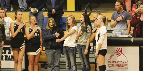 Bobby Gutierrez photo Members of the Meeker High School Choir sing the Star-Spangled Banner before a volleyball game.