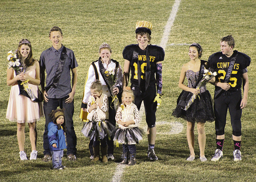 The Meeker High School Homecoming royalty for 2016 took to the field at Starbuck Stadium at halftime of the Friday night football game. Left to right are first attendants Isabel Feichter and Austin Russell, queen Maggie Phelan and king Cole Brown, and second attendants Loran Casias and Doak Mantle. The crown bearers (in front) were Casey, Graysie and Hannah Coryell. bobby gutierrez photo