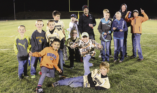 NFL Punt, Pass & Kick participants from ages 6-15 competed against their peers. Winners can attend the sectional event in Grand Junction Oct. 23. Pictured are Finley Deming, lying down; Said Valeriano, kneeling; Bryce Barth, Dillon Hobbs; Dexter Chinn, Tucker Chinn, Snowden Williams, Hayden Shults, Ethan Quinn, ERBM recreation assistant Mike Pfister, Madison Mendenhall, John Hampton Hightower, Autumn Hobbs, Ryan Phelan and Liam Deming, standing. Bobby Gutierrez  photo