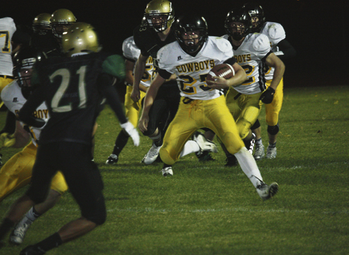 becky hughes photo Meeker junior running back Doak Mantle prepares to make a cut against the Monte Vista Pirates last Friday. Mantle carried the ball 25 times for 249 yards, three touchdowns and two, two-point conversions. Mantle is also a linebacker on defense, where he finished with eight tackles and one interception. The Cowboys will play their first league game of the season against the Bulldogs Friday in Hotchkiss.