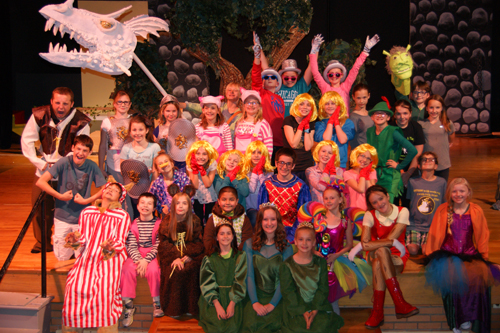 """Members of the cast of Shrek on stage (above) and on a float in the homecoming parade. The Meeker Arts and Cultural Council Center State Youth Theatrical Group will present the musical """"Shrek"""" at the Meeker High School auditorium Dec. 1, 2 and 3. The actors in the production are third through ninth graders. Courtesy Photo"""
