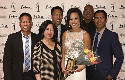 """courtesy photo CNCC alumnae Alyssa Mae Magalong finished in the top 15 as a semi-finalist in the Miss Colorado USA Pageant. She was awarded a semi-finalist trophy and scholarship for $36,000 to Lindenwood University. The Miss Colorado contestants also voted her """"Miss Congeniality."""" She was recognized and awarded a plaque. """"It was wonderful to see some of my pageant friends. I also met a lot of new ones. I'm honored to have been able to compete with women of high caliber. It was a very special and exciting pageant weekend at the Union Colony Civic Center with my family, former WSCU volleyball teammates and friends cheering me on. I'd also like to thank those who watched me compete live streamed, as well as all of my supporters for your continued support,"""" Magalong said.  Front row: Maria, Alyssa and Andrew Magalong. Back row: Alexander, Anthony and Felix Magalong Jr."""
