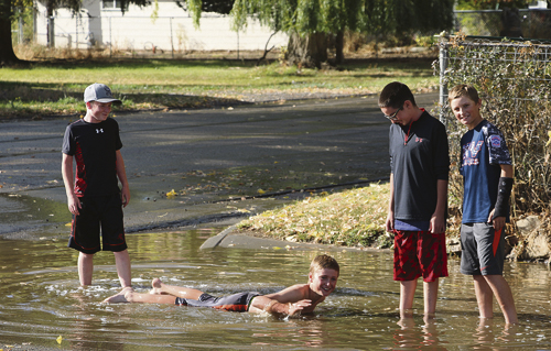 These young gentlemen found a way to enjoy one of the last warm weather days of the year with the help of this large puddle. Who says kids don't know how to have fun anymore?  Margaret Slaugh Photo