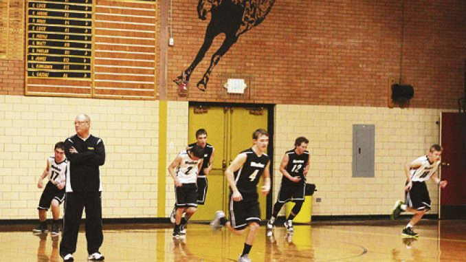 Meeker boys' basketball coach Klark Kindler is pictured with several of his players running sprints during a recent practice. The Cowboys will start league play Friday in Kremmling, then host the Hayden Tigers Saturday. Bobby Gutierrez photo
