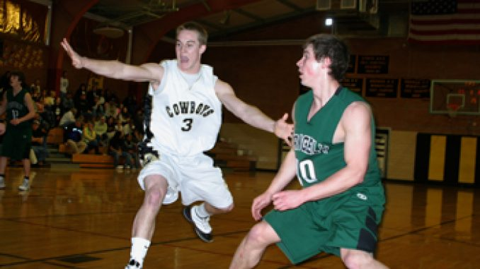 Meeker's Jake Nieslanik guarded Rangely's Patrick Phelan during last Saturday's district game. The top-ranked Cowboys won handily to advance to this weekend's next round, to be played today at 7:30 in Rangely. The loss ended the Panthers' season.