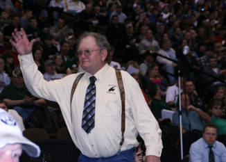 """Meeker assistant wrestling coach Sam Love was honored at the state tournament for 44 years of coaching. """"I have really enjoyed doing this for that many years,"""" said Love, whose son Pat competed at state."""