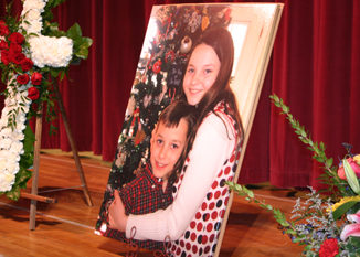 An enlarged photo of brother and sister Stone and Alahna Martin was the backdrop for last Friday's memorial service for Stone in the auditorium at Meeker High School. Nearly every seat was taken as family and friends paid their respects. See additional photos, Jerry Martin's eulogy for his grandson and Stone's obituary on Pages 6 and 7.