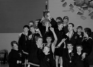 Barone Middle School wrestlers celebrated winning the first-place team trophy last Saturday at a tournament in Hayden.