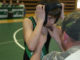 Rangely wrestler Ketsen Rouse received some last-minute coaching before taking the mat during last week's home dual against Meeker's Barone Middle School.