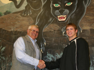 Bill Turner, who won Rangely's first individual state wrestling title, congratulates the newest Panther state champion Travis Witherell. Turner won the 165-pound class in 1958 and Witherell won the 152-pound state title Feb. 20.