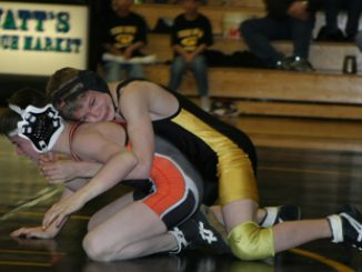 Barone Middle School's J.C. Henderson won all of his matches at Saturday's home tournament and the Cowboys finished first in team scoring.