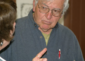 Joe Livingston, who lives upriver, talked with Ellene Meece of the Meeker Chamber of Commerce after last week's master plan meeting. Livingston and other residents asked several questions of the presenters. The event was attended by about 30 people.